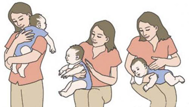 Як правильно тримати новонародженого стовпчиком